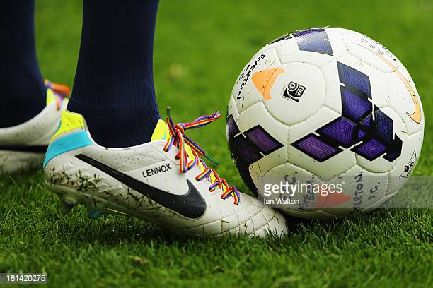 John Heitinga of Everton wears rainbowcoloured shoe laces as part of a campaign against homophobia in football before the Barclays Premier League...