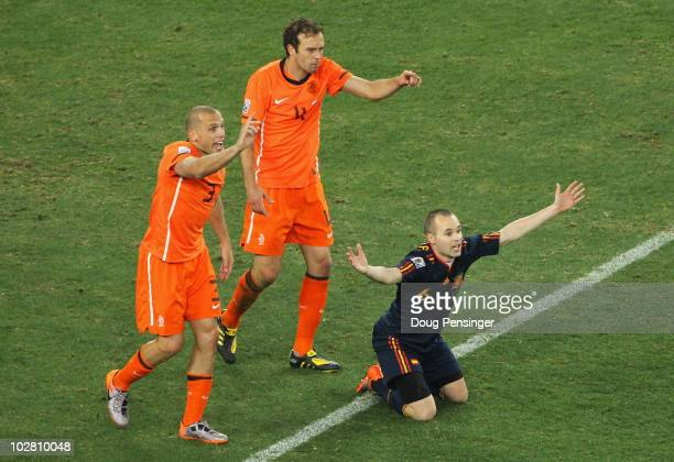 John Heitinga of the Netherlands appeals following his second bookable offence for a challenge on Andres Iniesta of Spain during the 2010 FIFA World...