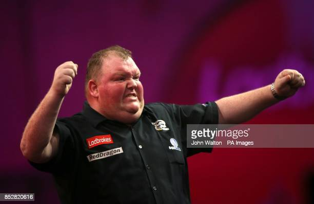 John Henderson celebrates winning his match against Dave Chisnall during day three of The Ladbrokes World Darts Championship at Alexandra Palace...
