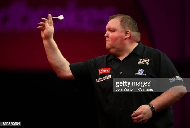 John Henderson in action during his match against Dave Chisnall during day three of The Ladbrokes World Darts Championship at Alexandra Palace London