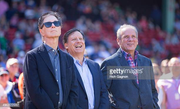 John Henry Tom Werner and Larry Lucchino share a laugh as Lucchino was being honored for his last home game as Red Sox CEO/President before a game...