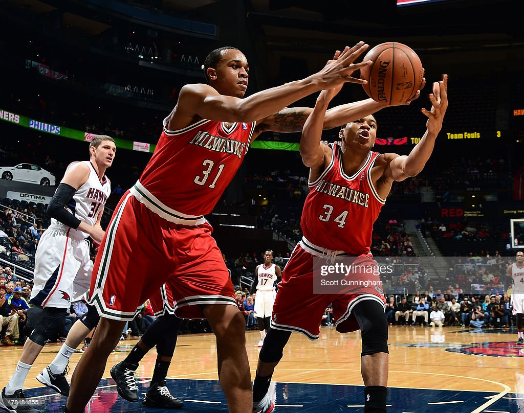 John Henson #31 and Giannis Antetokounmpo #34 of the Milwaukee Bucks go for a rebound against the Atlanta Hawks on March 13, 2014 at Philips Arena in Atlanta, Georgia.