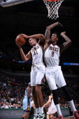 John Henson and Larry Sanders of the Milwaukee Bucks jump for a rebound against the Memphis Grizzlies on January 1 2014 at the BMO Harris Bradley...