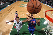 John Henson of the Milwaukee Bucks and Joel Anthony of the Detroit Pistons go up for a rebound during a preseason game on October 10 2015 at the BMO...