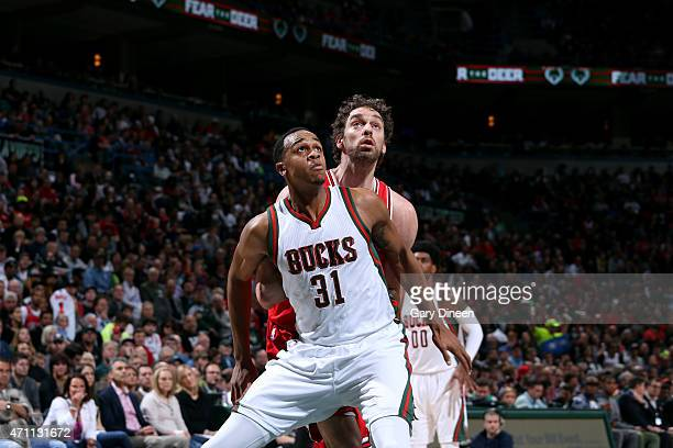 John Henson of the Milwaukee Bucks battles for position against Pau Gasol of the Chicago Bulls in Game Four of the Eastern Conference Quarterfinals...