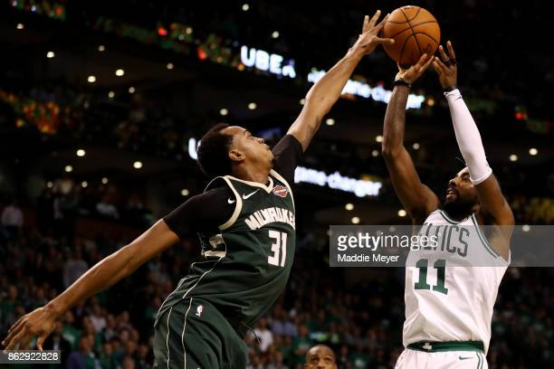 John Henson of the Milwaukee Bucks blocks a shot from Kyrie Irving of the Boston Celtics during the fourth quarter at TD Garden on October 18 2017 in...