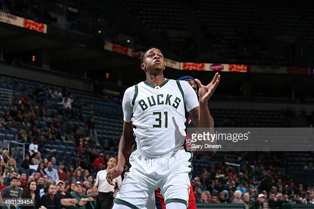 John Henson of the Milwaukee Bucks boxes out against the Washington Wizards during a preseason game on October 17 2015 at the BMO Harris Bradley...