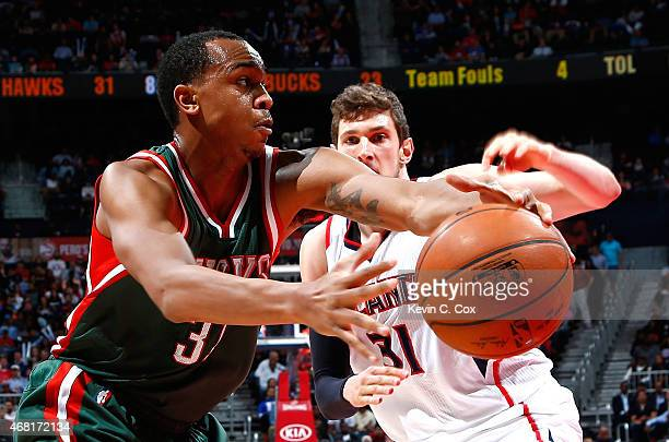 John Henson of the Milwaukee Bucks drives against Mike Muscala of the Atlanta Hawks at Philips Arena on March 30 2015 in Atlanta Georgia NOTE TO USER...