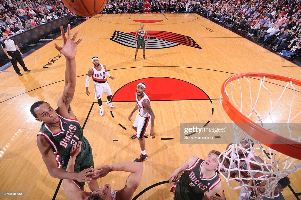 John Henson #31 of the Milwaukee Bucks drives to the basket against the Portland Trail Blazers on March 18, 2014 at the Moda Center Arena in Portland, Oregon.