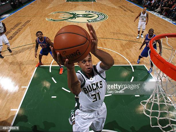 John Henson of the Milwaukee Bucks drives to the basket against the New York Knicks on October 28 2015 at the BMO Harris Bradley Center in Milwaukee...