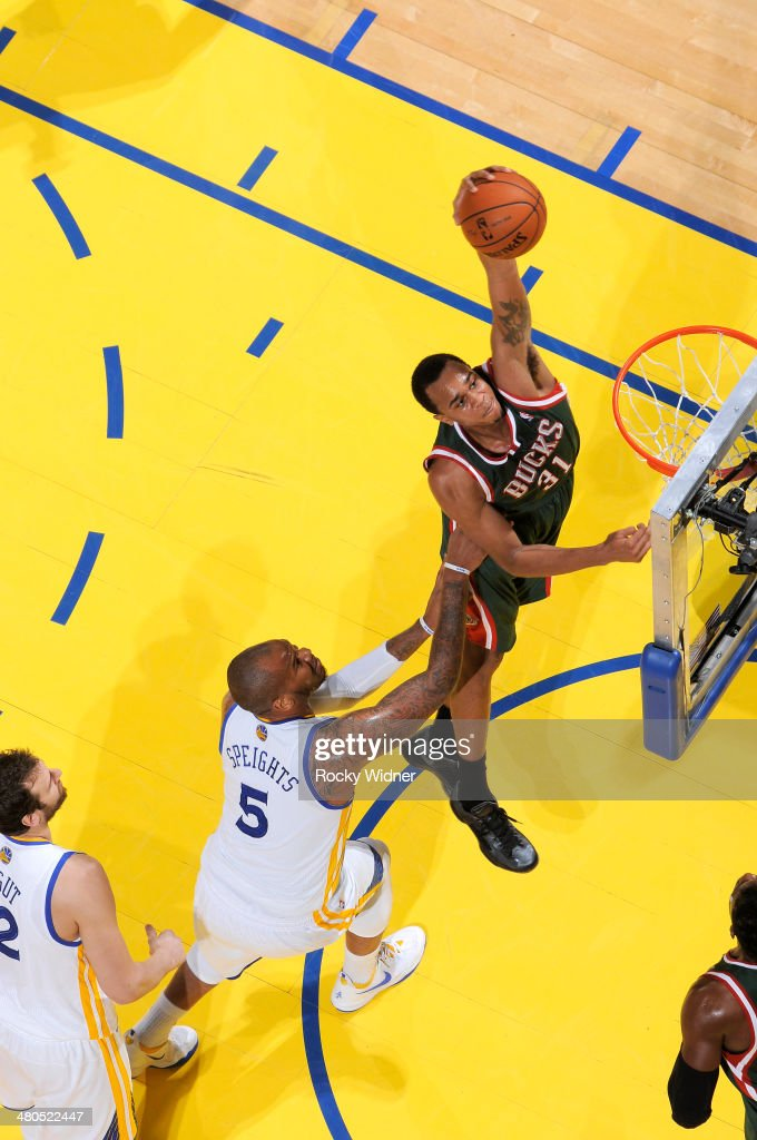 John Henson #31 of the Milwaukee Bucks dunks against <a gi-track='captionPersonalityLinkClicked' href=/galleries/search?phrase=Marreese+Speights&family=editorial&specificpeople=4187263 ng-click='$event.stopPropagation()'>Marreese Speights</a> #5 of the Golden State Warriors on March 20, 2014 at Oracle Arena in Oakland, California.