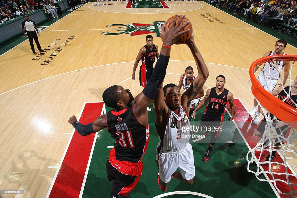 John Henson #31 of the Milwaukee Bucks dunks against <a gi-track='captionPersonalityLinkClicked' href=/galleries/search?phrase=Terrence+Ross&family=editorial&specificpeople=6781663 ng-click='$event.stopPropagation()'>Terrence Ross</a> #31 of the Toronto Raptors on November 2, 2013 at the BMO Harris Bradley Center in Milwaukee, Wisconsin.