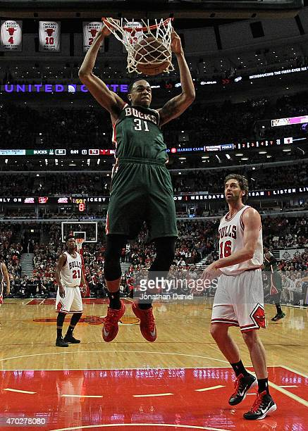 John Henson of the Milwaukee Bucks dunks past Pau Gasol of the Chicago Bulls during the first round of the 2015 NBA Playoffs at the United Center on...