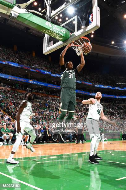 John Henson of the Milwaukee Bucks dunks the ball against the Boston Celtics on October 18 2017 at the TD Garden in Boston Massachusetts NOTE TO USER...