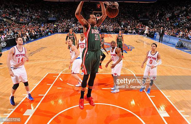John Henson of the Milwaukee Bucks dunks the ball against the New York Knicks at Madison Square Garden on April 10 2015 in New York New York NOTE TO...