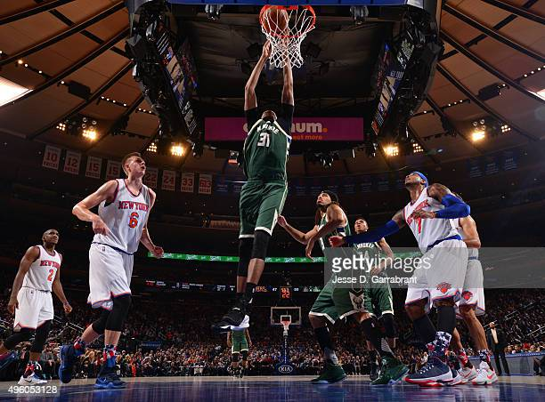 John Henson of the Milwaukee Bucks dunks the ball against the New York Knicks at Madison Square Garden on November 6 2015 in New YorkNew York NOTE TO...
