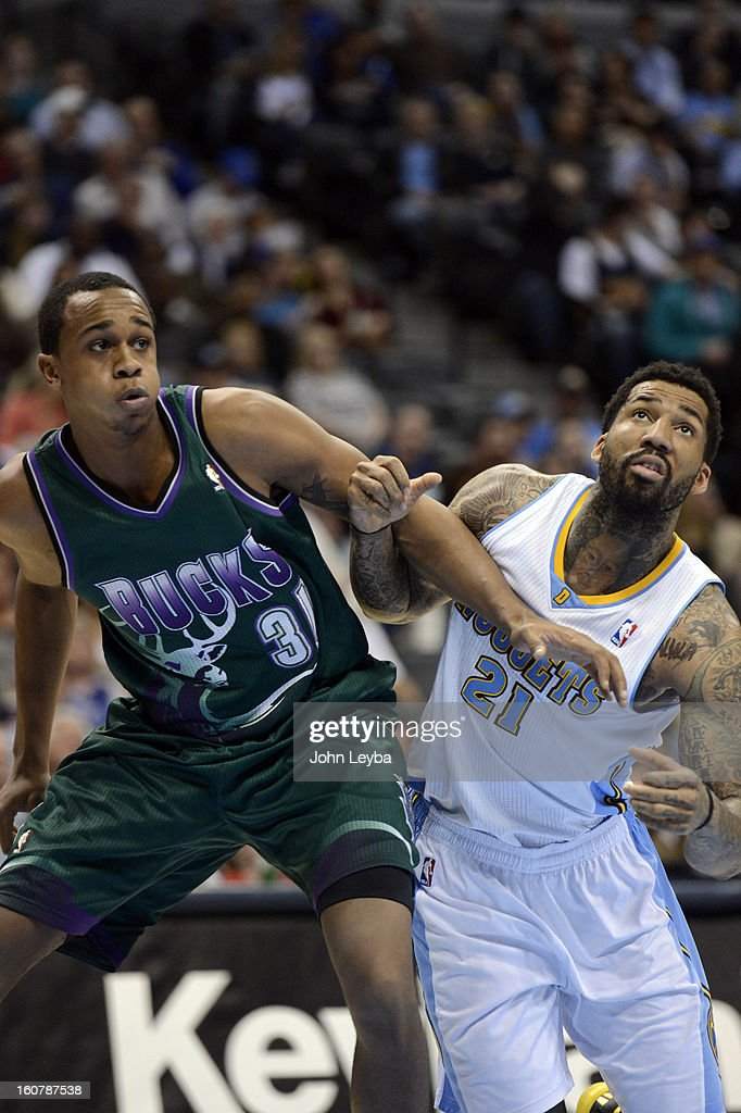 John Henson (31) of the Milwaukee Bucks fights for position with Wilson Chandler (21) of the Denver Nuggets during the first quarter February 05, 2013 at Pepsi Center. The Denver Nuggets take on the Milwaukee Bucks in NBA action.