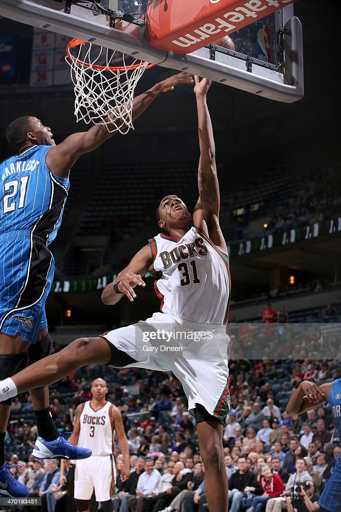 John Henson #31 of the Milwaukee Bucks goes up for a shot against the Orlando Magic on February 18, 2014 at the BMO Harris Bradley Center in Milwaukee, Wisconsin.