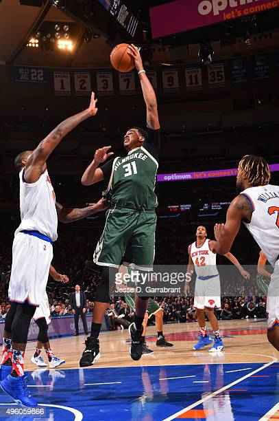John Henson of the Milwaukee Bucks goes up for the hook shot against the New York Knicks at Madison Square Garden on November 6 2015 in New YorkNew...