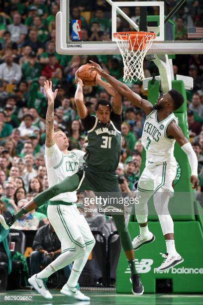 John Henson of the Milwaukee Bucks grabs the rebound against the Boston Celtics on October 18 2017 at the TD Garden in Boston Massachusetts NOTE TO...