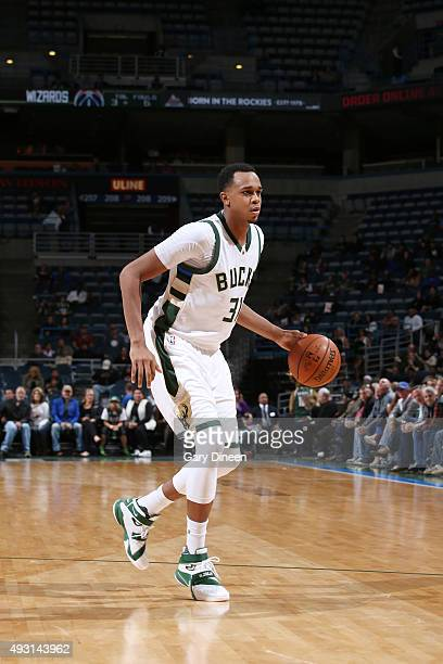 John Henson of the Milwaukee Bucks handles the ball against the Washington Wizards during a preseason game on October 17 2015 at the BMO Harris...