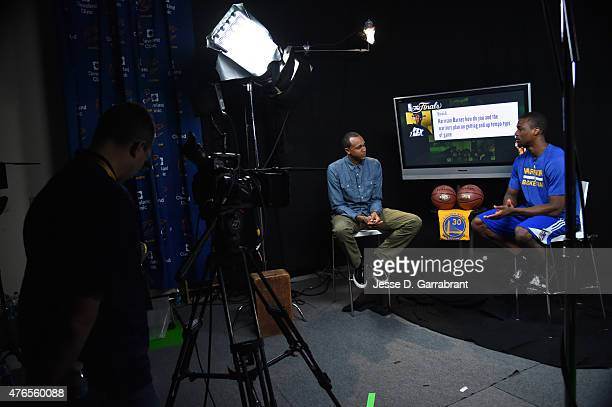 John Henson of the Milwaukee Bucks interviews Harrison Barnes of the Golden State Warriors for Facebook Live during media availability as part of the...