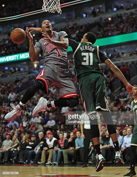 John Henson of the Milwaukee Bucks knocks the ball away from Derrick Rose of the Chicago Bulls at the United Center on January 5 2016 in Chicago...