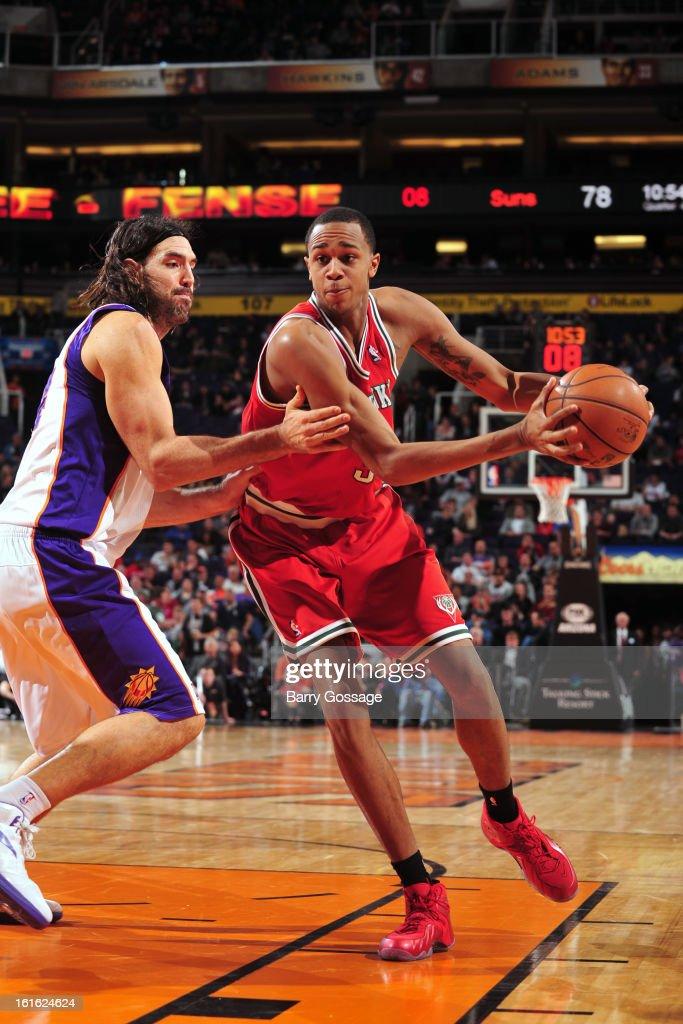 John Henson #31 of the Milwaukee Bucks looks to pass the ball against the Phoenix Suns on January 17, 2013 at U.S. Airways Center in Phoenix, Arizona.