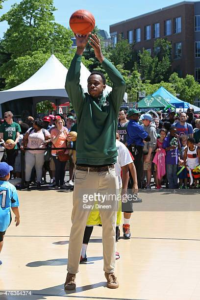 John Henson of the Milwaukee Bucks plays games with fans at the Bucks Summer Block Party on June 6 2015 at the Schlitz Park StockHouse grounds in...