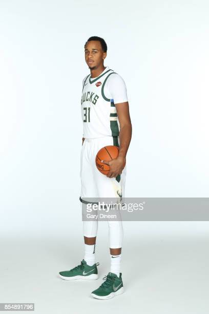 John Henson of the Milwaukee Bucks poses for a portrait during the 201718 NBA Media Day on September 25 2017 at the BMO Harris Bradley Center in...