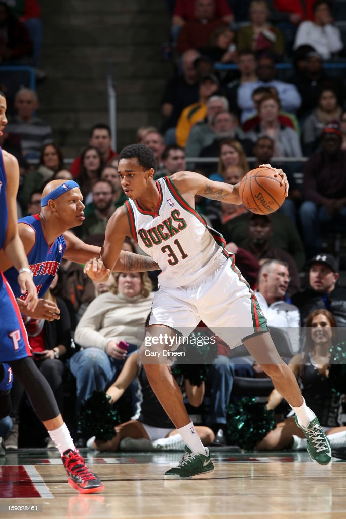 John Henson #31 of the Milwaukee Bucks posts-up against Charlie Villanueva #31 of the Detroit Pistons on January 11, 2013 at the BMO Harris Bradley Center in Milwaukee, Wisconsin.