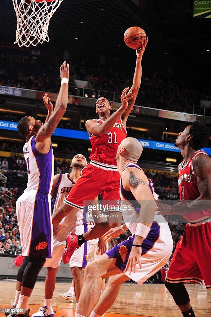 John Henson #31 of the Milwaukee Bucks puts up a shot against the Phoenix Suns on January 17, 2013 at U.S. Airways Center in Phoenix, Arizona.