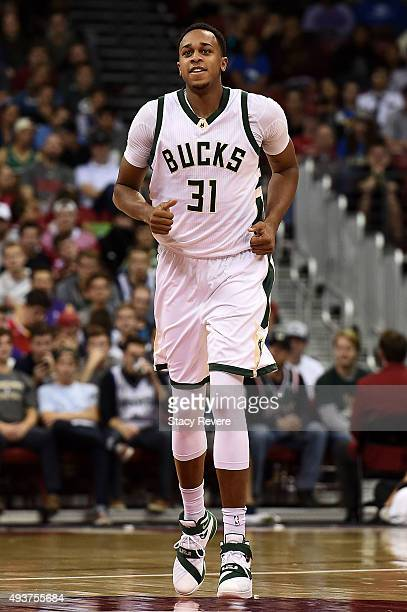 John Henson of the Milwaukee Bucks reacts to a score during a preseason game against the Minnesota Timberwolves at the Kohl Center on October 20 2015...