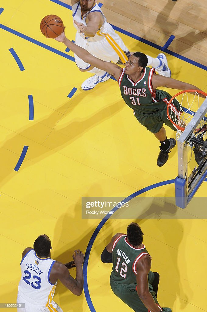 John Henson #31 of the Milwaukee Bucks rebounds against the Golden State Warriors on March 20, 2014 at Oracle Arena in Oakland, California.