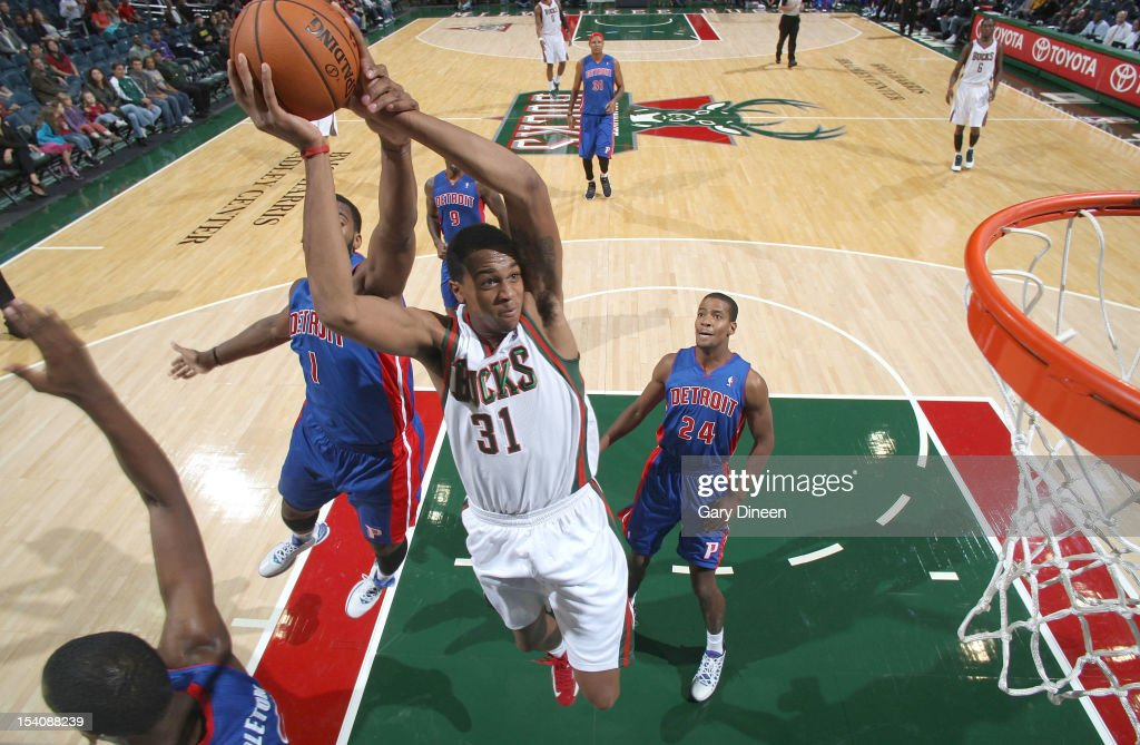 John Henson #31 of the Milwaukee Bucks shoots against <a gi-track='captionPersonalityLinkClicked' href=/galleries/search?phrase=Andre+Drummond&family=editorial&specificpeople=7122456 ng-click='$event.stopPropagation()'>Andre Drummond</a> #1 of the Detroit Pistons during the NBA preseason game on October 13, 2012 at the BMO Harris Bradley Center in Milwaukee, Wisconsin.