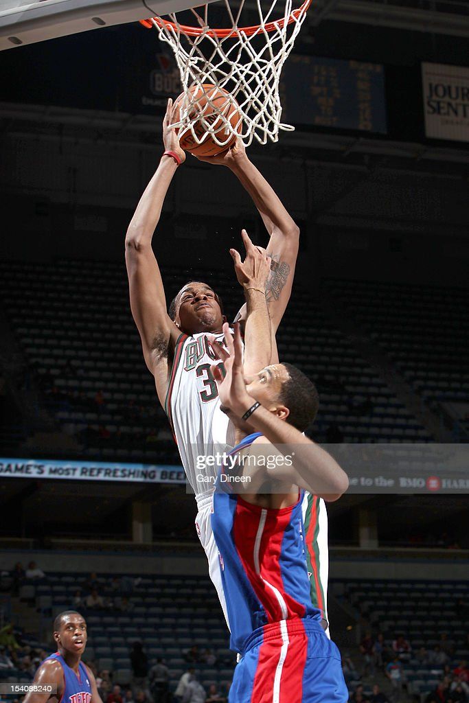 John Henson #31 of the Milwaukee Bucks shoots against <a gi-track='captionPersonalityLinkClicked' href=/galleries/search?phrase=Austin+Daye&family=editorial&specificpeople=4682416 ng-click='$event.stopPropagation()'>Austin Daye</a> #5 of the Detroit Pistons during the NBA preseason game on October 13, 2012 at the BMO Harris Bradley Center in Milwaukee, Wisconsin.