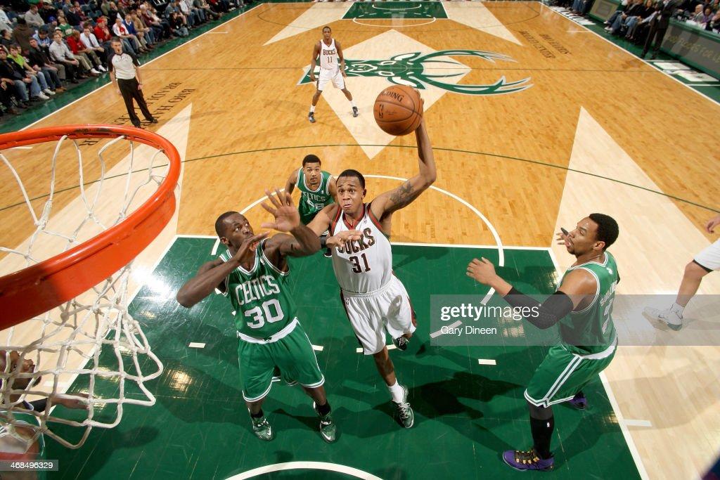 John Henson #31 of the Milwaukee Bucks shoots against the Boston Celtics on February 10, 2014 at the BMO Harris Bradley Center in Milwaukee, Wisconsin.