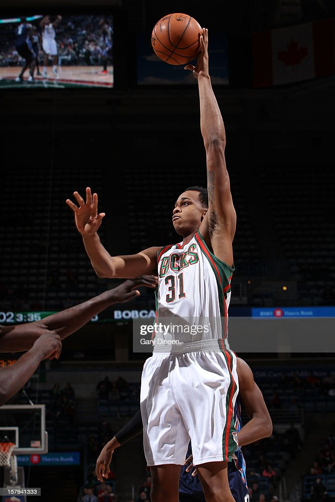 John Henson #31 of the Milwaukee Bucks shoots against the Charlotte Bobcats during the game on December 7, 2012 at the BMO Harris Bradley Center in Milwaukee, Wisconsin.