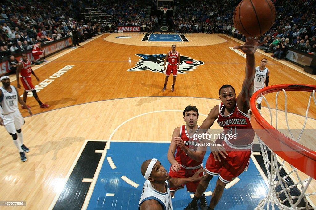 John Henson #31 of the Milwaukee Bucks shoots against the Minnesota Timberwolves on March 11, 2014 at Target Center in Minneapolis, Minnesota.