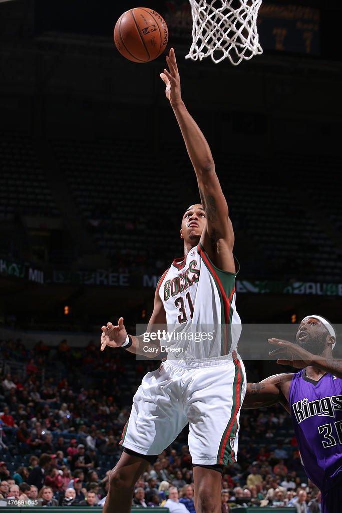 John Henson #31 of the Milwaukee Bucks shoots against the Sacramento Kings on March 5, 2014 at the BMO Harris Bradley Center in Milwaukee, Wisconsin.