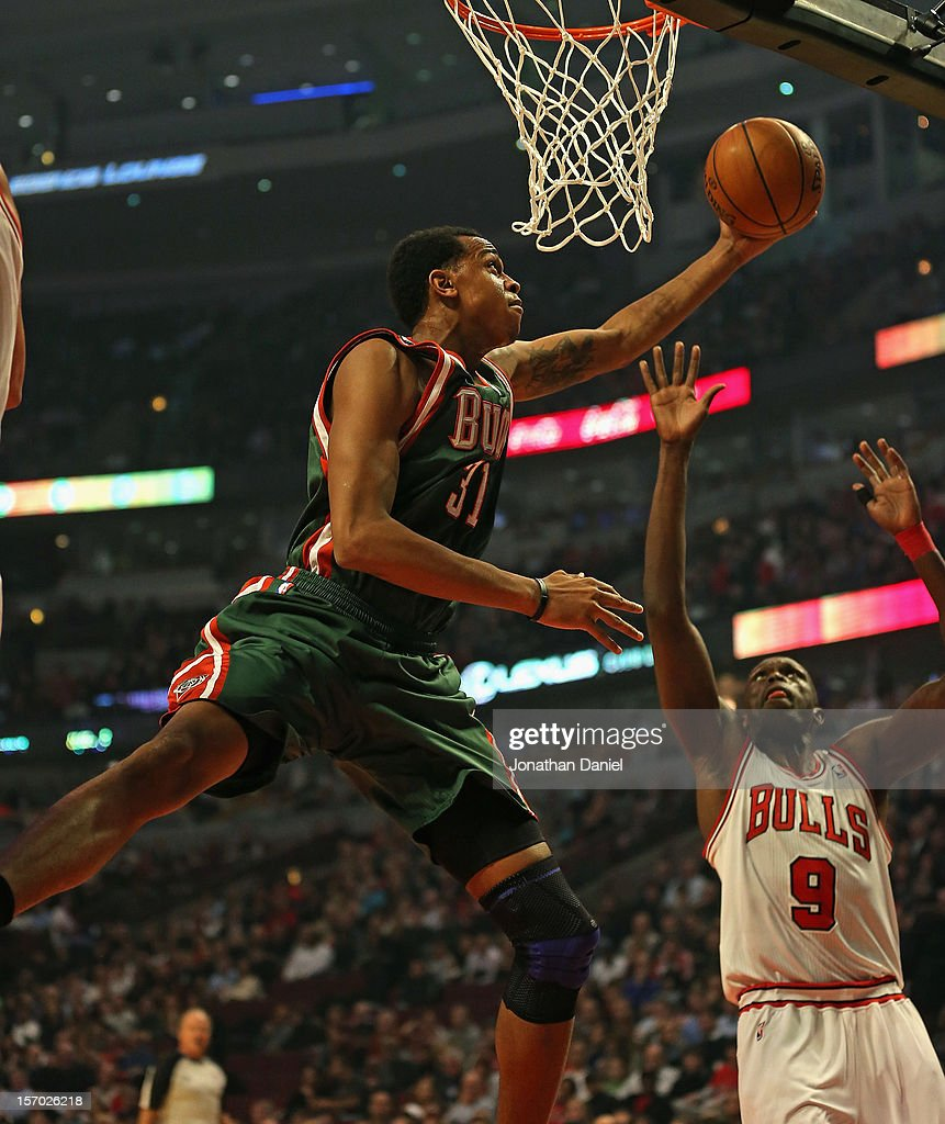 John Henson #21 of the Milwaukee Bucks shoots over Loul Deng #9 of the Chicago Bulls at the United Center on November 26, 2012 in Chicago, Illinois. The Bucks defeated the Bulls 93-92.