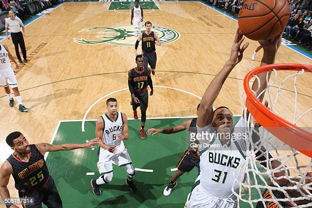 John Henson of the Milwaukee Bucks shoots the ball against the Atlanta Hawks on January 15 2016 at the BMO Harris Bradley Center in Milwaukee...