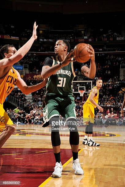 John Henson of the Milwaukee Bucks shoots the ball against the Cleveland Cavaliers on October 13 2015 at Quicken Loans Arena in Cleveland Ohio NOTE...
