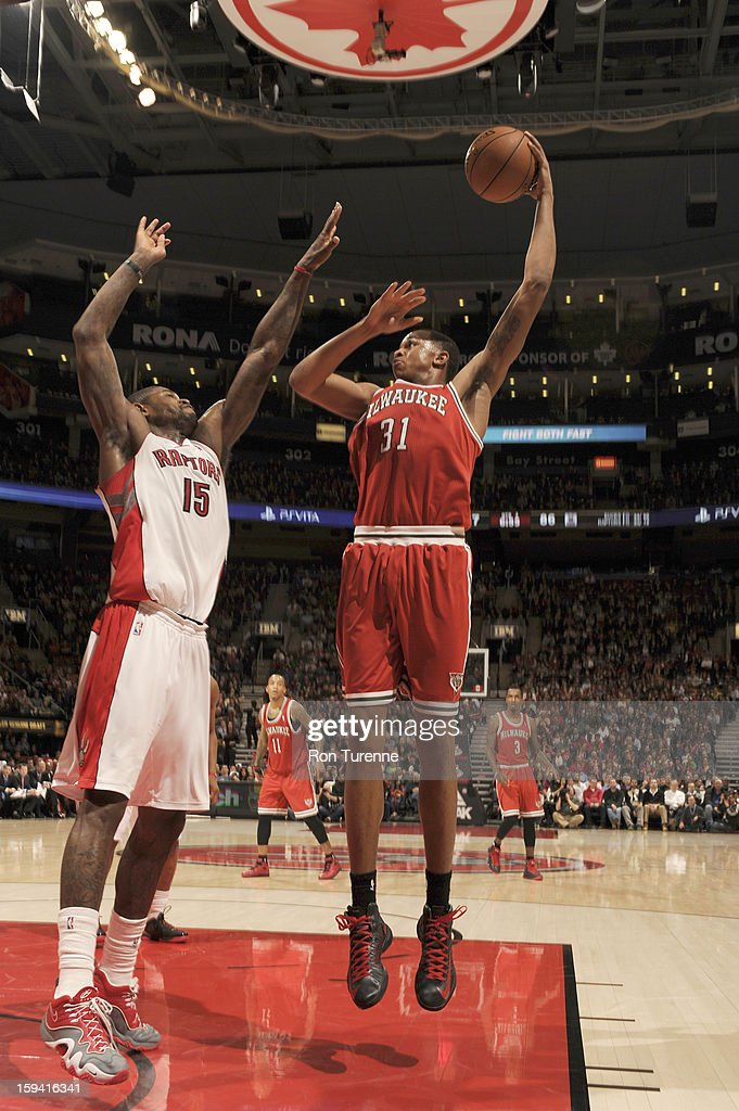 John Henson #31 of the Milwaukee Bucks shoots the ball over <a gi-track='captionPersonalityLinkClicked' href=/galleries/search?phrase=Amir+Johnson&family=editorial&specificpeople=556786 ng-click='$event.stopPropagation()'>Amir Johnson</a> #15 of the Toronto Raptors during the game between the Toronto Raptors and the Milwaukee Bucks on January 13, 2013 at the Air Canada Centre in Toronto, Ontario, Canada.