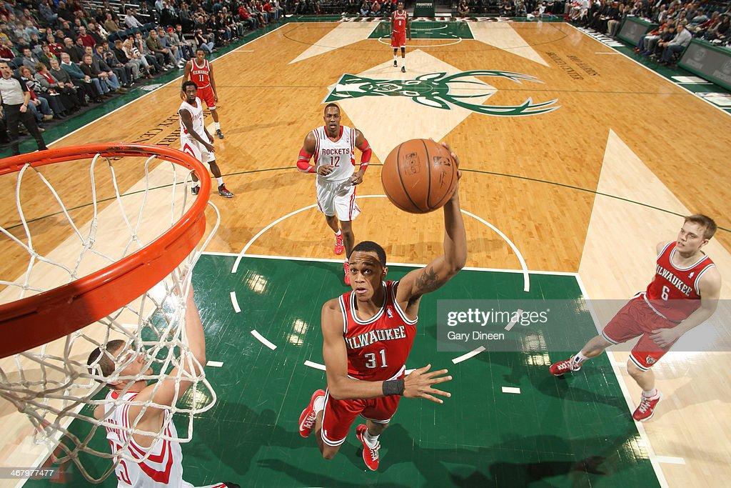 John Henson #31 of the Milwaukee Bucks shoots the Houston Rockets on February 8, 2014 at the BMO Harris Bradley Center in Milwaukee, Wisconsin.
