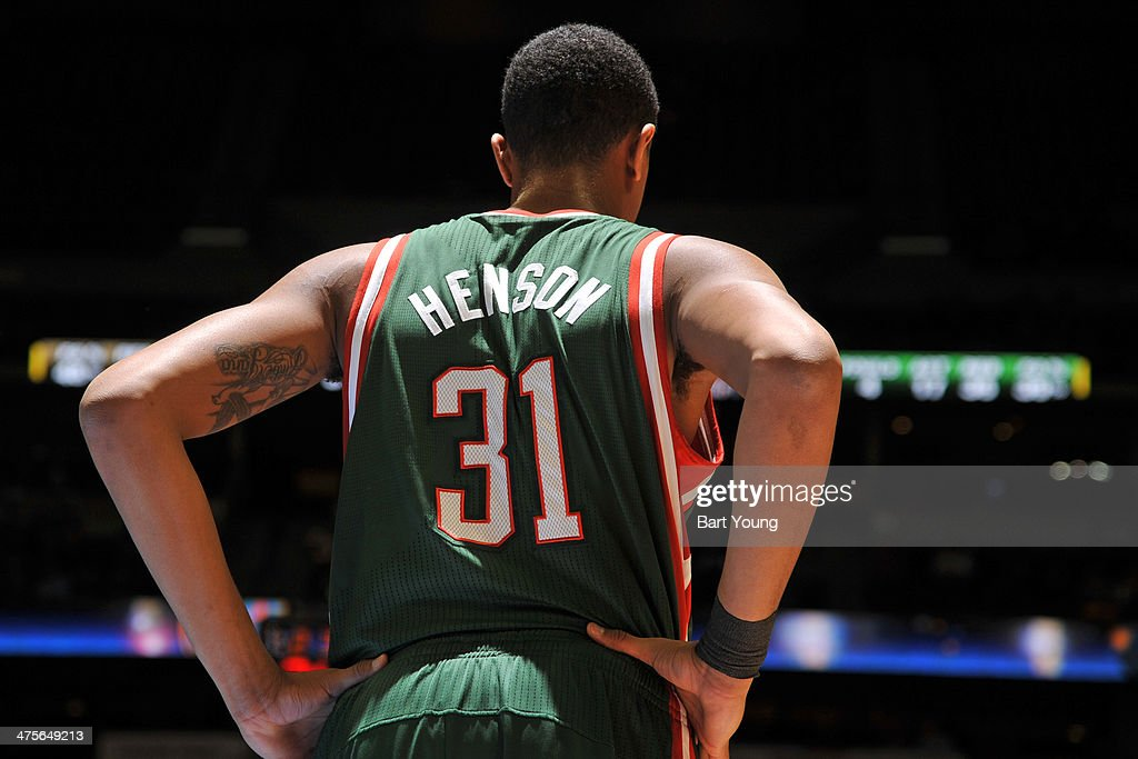 John Henson #31 of the Milwaukee Bucks stands on the court against the Denver Nuggets on February 5, 2014 at the Pepsi Center in Denver, Colorado.