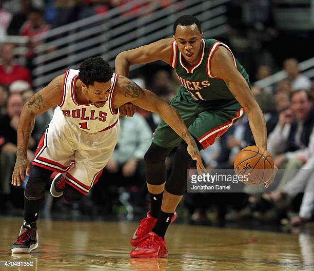 John Henson of the Milwaukee Bucks steals the ball from Derrick Rose of the Chicago Bulls during the first round of the 2015 NBA Playoffs at the...