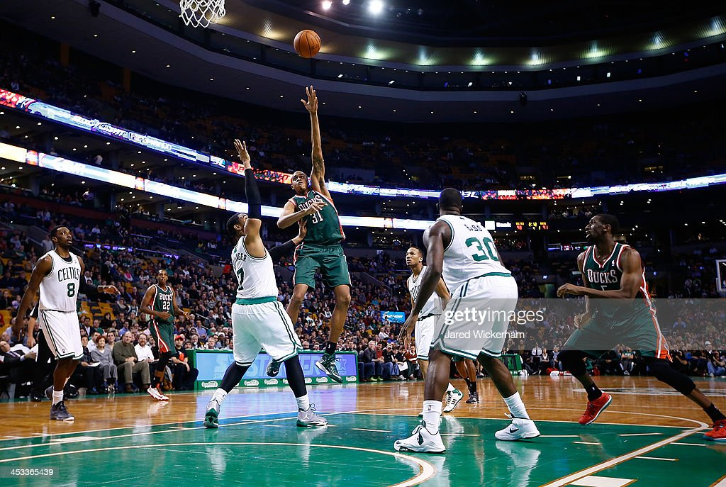 John Henson #31 of the Milwaukee Bucks takes a shot over <a gi-track='captionPersonalityLinkClicked' href=/galleries/search?phrase=Jared+Sullinger&family=editorial&specificpeople=6866665 ng-click='$event.stopPropagation()'>Jared Sullinger</a> #7 of the Boston Celtics in the second half during the game at TD Garden on December 3, 2013 in Boston, Massachusetts.