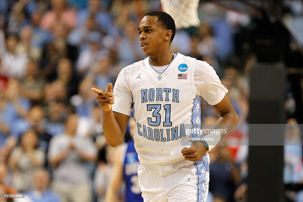 John Henson of the North Carolina Tar Heels points at a teammate after making a basket against the Creighton Bluejays in the first half during the...