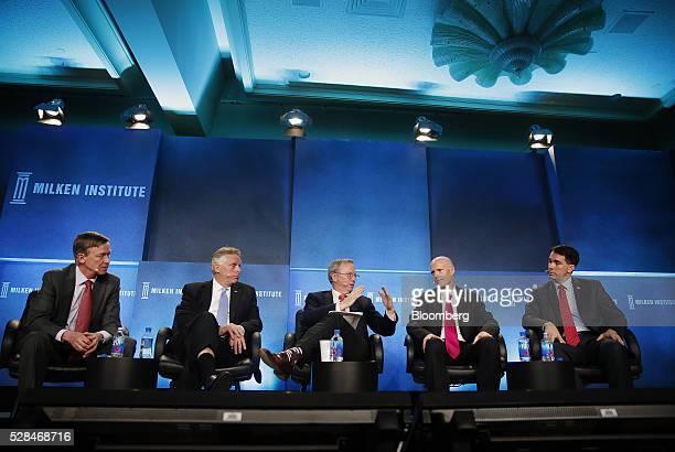 John Hickenlooper governor of Colorado from left Terry McAuliffe governor of Virginia Eric Schmidt executive chairman of Alphabet Inc Rick Scott...